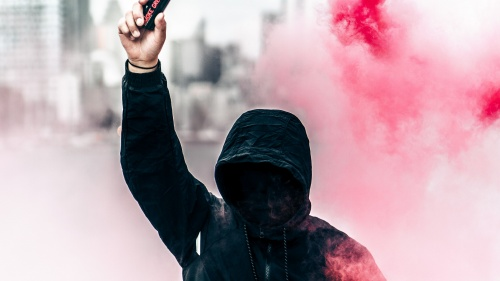 Protester with can of smoke
