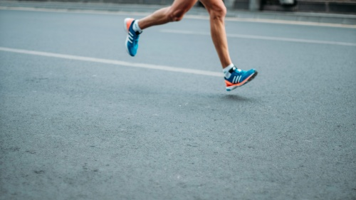 You Can Be a Successful Runner, a cropped image of a man's legs running on pavement