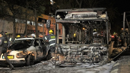 An Israeli bus and car destroyed by Hamas missiles fired at Israeli civilians from Gaza.