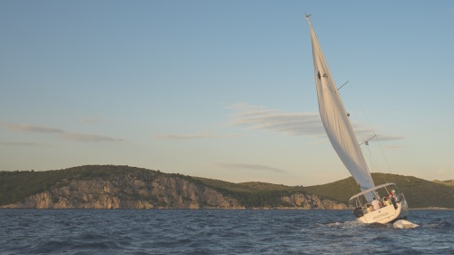 A sailboat leaning into the wind.