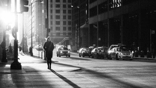 A woman walking on a busy city street.