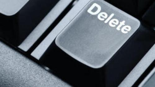 Delete key on computer keyboard.