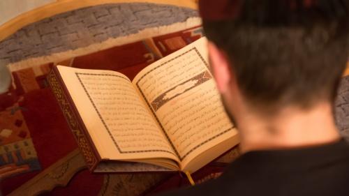Man reading the Koran