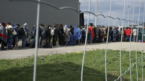 A line of Syrian refugees crossing the border of Hungary and Austria on their way to Germany.