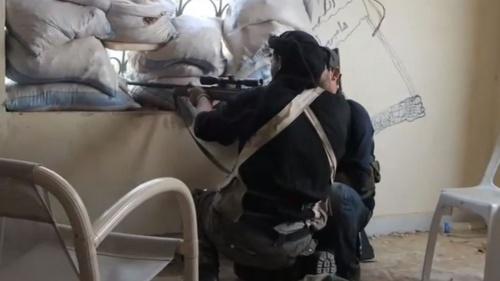 A Syrian rebel sniper in Khan al-Assal, Aleppo province in 2013.
