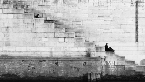 A person sitting on old stairs.