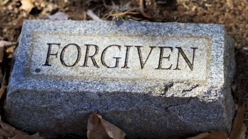 """Forgiven"" engraved on a tombstone."
