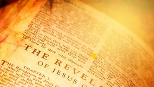 Bible opened to the book of Revelation.