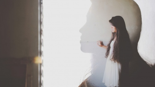 The silhouette of a young woman.