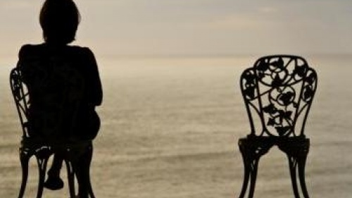 Woman and empty chair - In the Shadow of Death