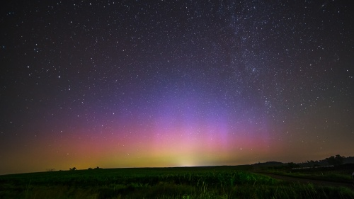 Stars in the night sky. Glowing horizon.