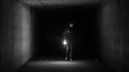 A person in a dark tunnel