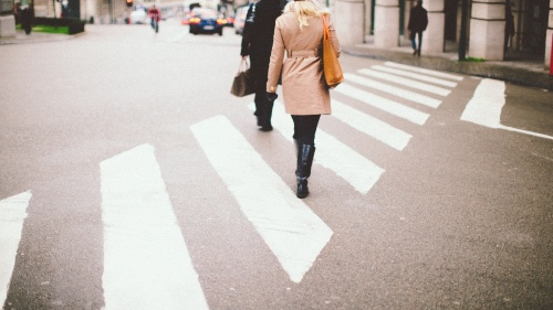 People walking across a street.