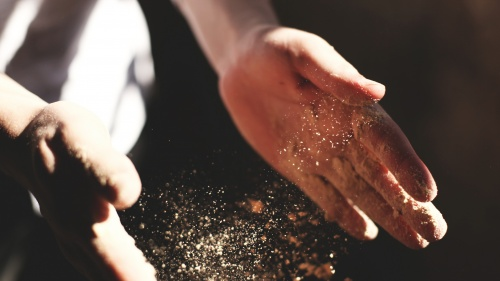 Dust falling out of hands.