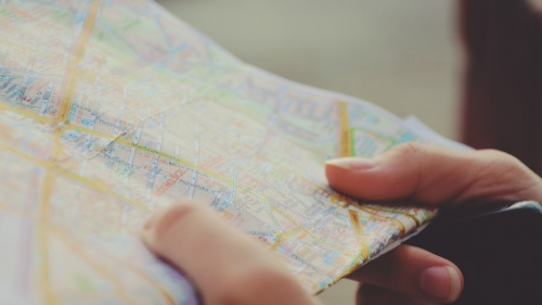 Hands holding a map.