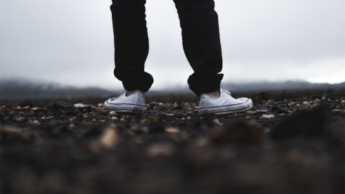 A man's legs while walking.