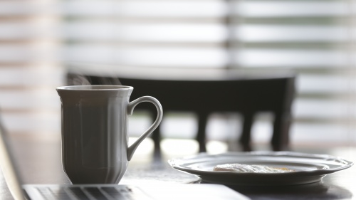 Coffee cup and plate on a table.