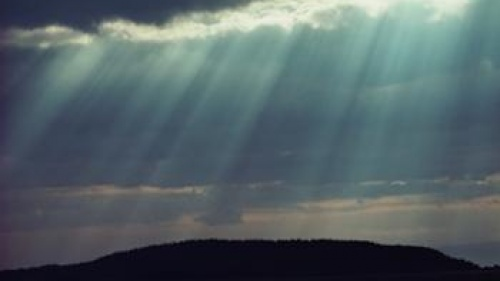 Sunlight rays coming through clouds.