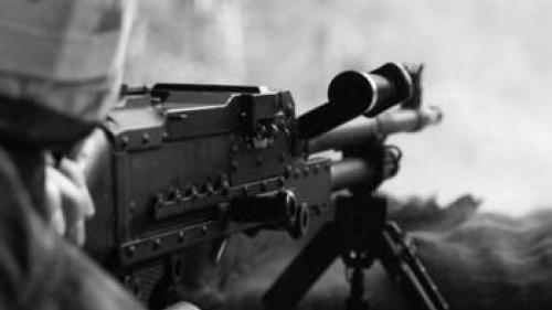 soldier firing gun