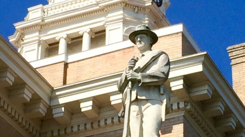 Confederate solider statue outside a courthouse.