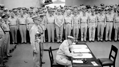 General of the Army Douglas MacArthur signing the Instrument of Surrender on behalf of the Allied Powers.