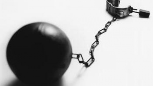 Ball and chain with hand cuff.