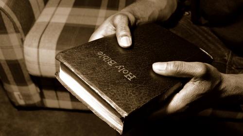 A man holding a Bible.