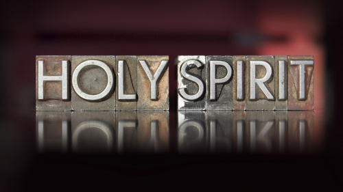 "Wood letterpress blocks that spell the word ""Holy Spirit""."