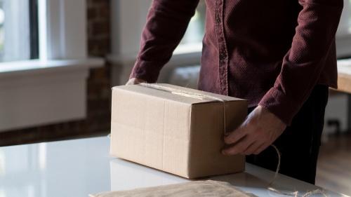 A man packaging a box.