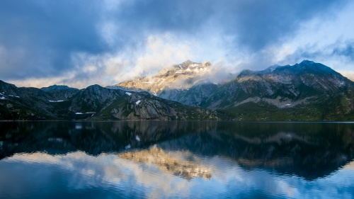 A photo of a beautiful scenery of mountains and a lake.