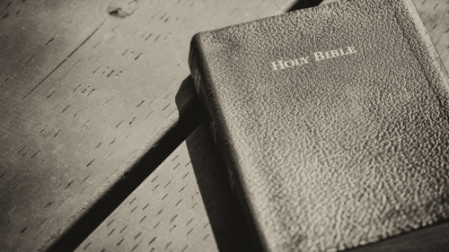 A Bible on a table.