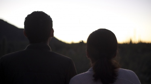 A young couple standing together.