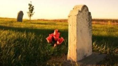 Grave with flowers at sunset - Understanding God's Word: The Resurrections of th