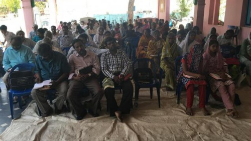 People in India listening to a Bible seminar