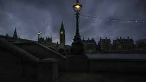 A night shot of London with Big Ben belltower in the distance.
