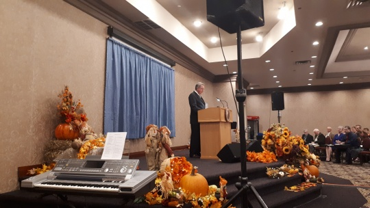 Aaron Dean speaks at Midland, Ontario.