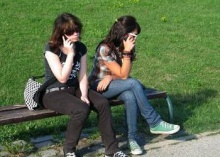 two girls on mobile phones