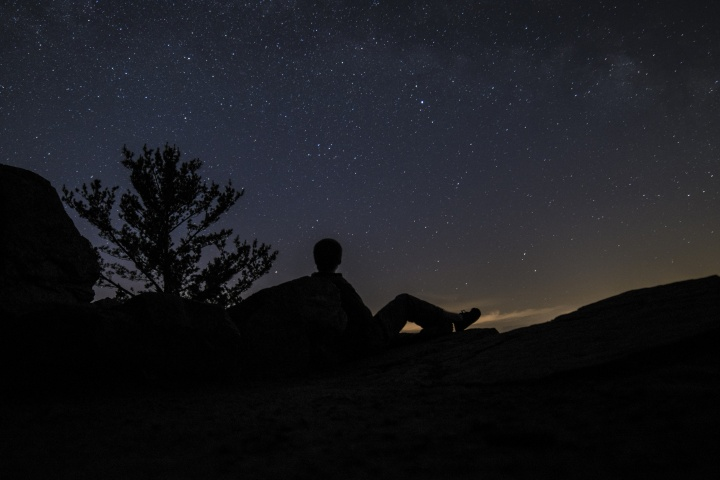 A Person Looking Up At The Millions Of Stars Filling The Night Sky