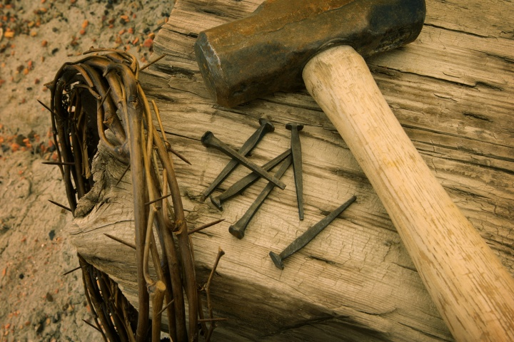 An reenactment of the items used in Jesus Christ cruxifixion - crown of thorns, nails, hammer and stake.