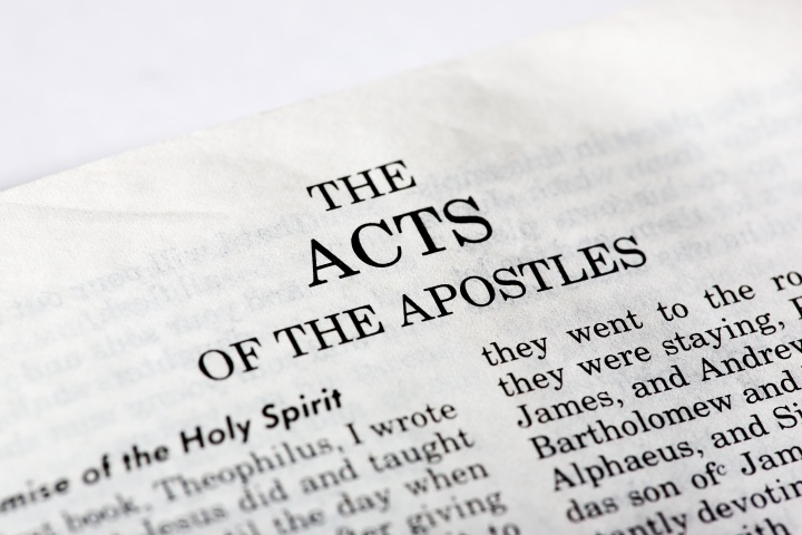 A Bible opened to the book of Acts.