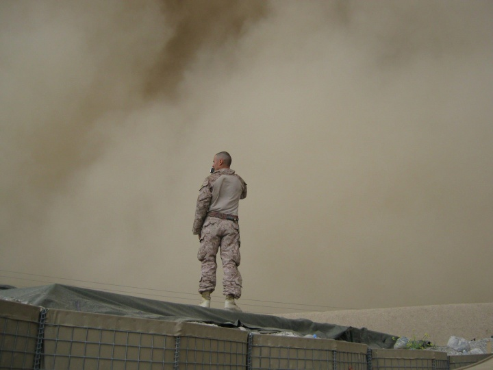 A soldier standing on top of a building.