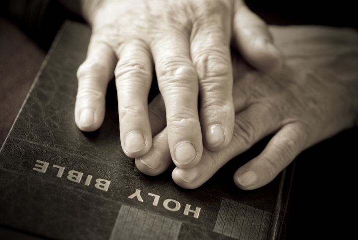 Hand on a Bible