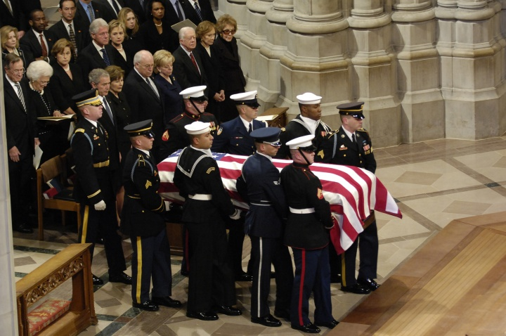 The casket of President Gerald R. Ford is carried past a group that includes President George W. Bush, first lady Laura Bush and Presidents George Bush Sr., Bill Clinton and Jimmy Carter at the National Cathedral in Washington Jan 2, 2007.