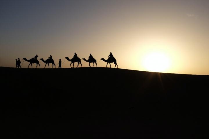 Men riding on camels.