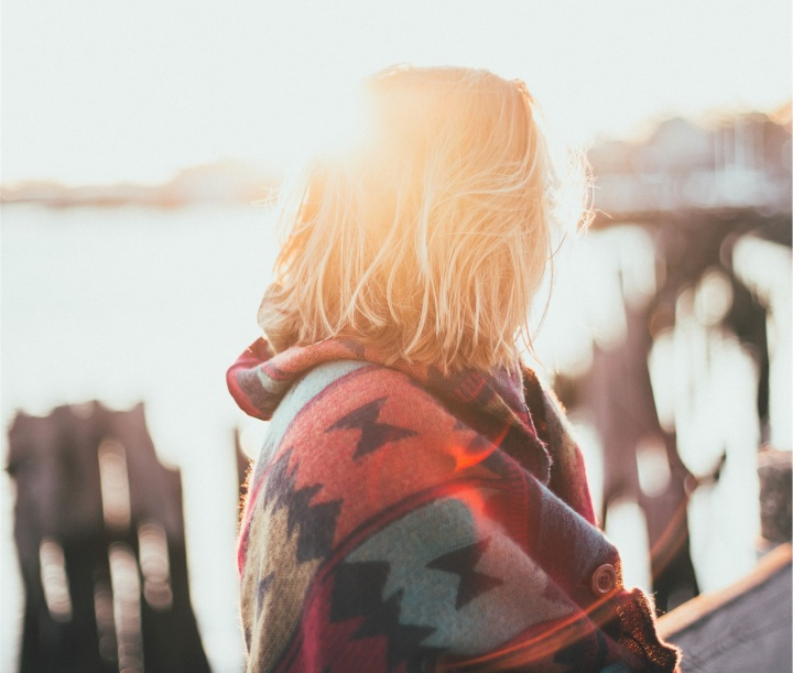 A woman with sunlight behind her.