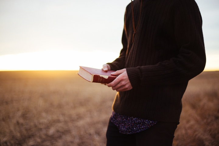 A man holding a Bible.