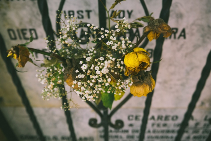 A gravestone and flowers.