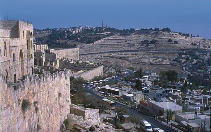 The prophet Zechariah describes how Jesus will return to the Mount of Olives (background, above), which overlooks Jerusalem (foreground) on the city's east side.