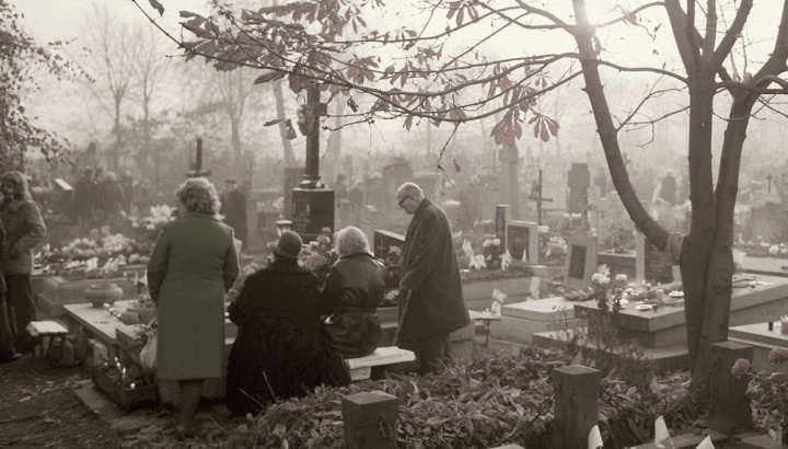 People at a grave site.