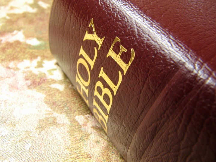 Bible laying on top of a table